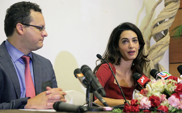 Human rights lawyer Amal Clooney (R) speaks as co-counsel Jared Genser looks on at a press conference at the Kurumba Maldives resort on the Maldives island of Vihamanafushi Photo: AFP